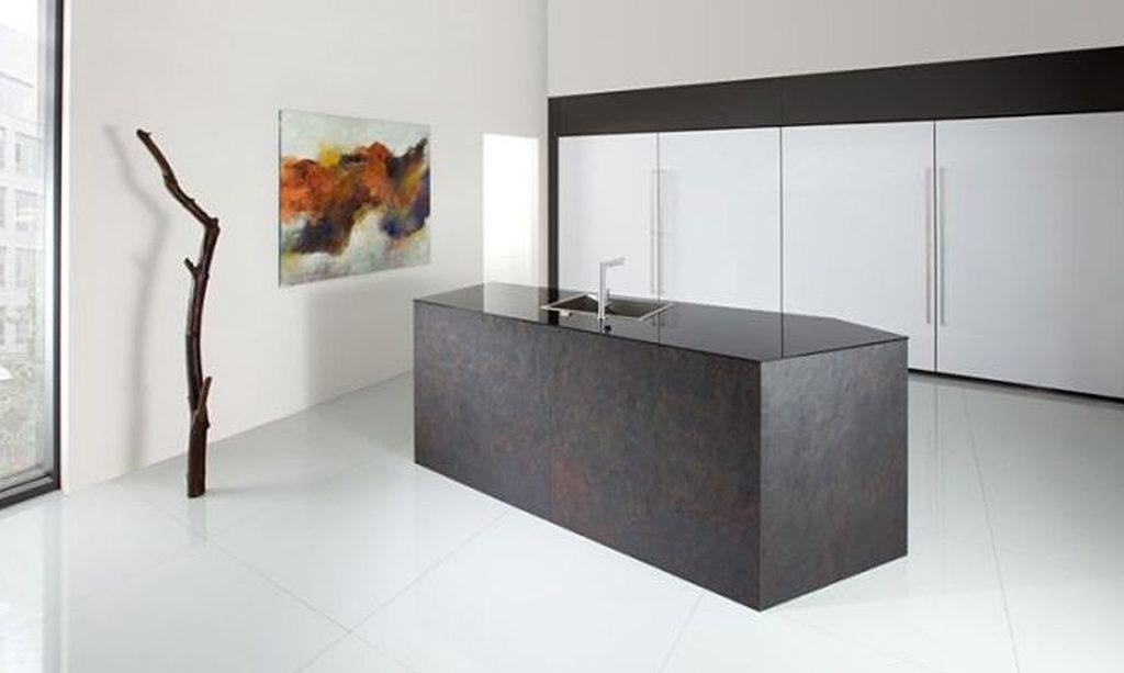 Rempp handle-less kitchen in stone veneer