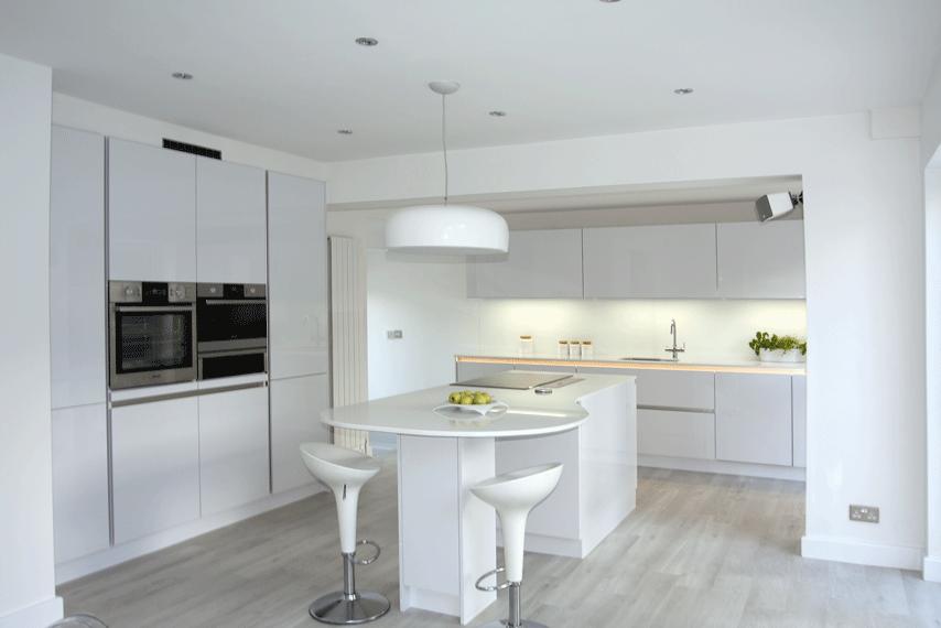 white handleless gloss kitchen